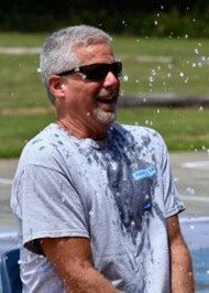 Mr. Fuller gets hit by water balloon