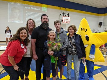 Student selected as Star of the Galaxy with her family and principal