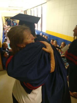 Coach Roberts and high school student embrace
