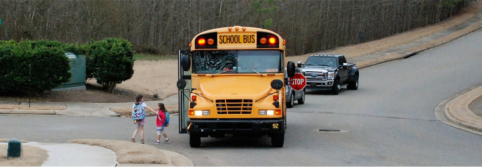 School bus with children getting off the bus