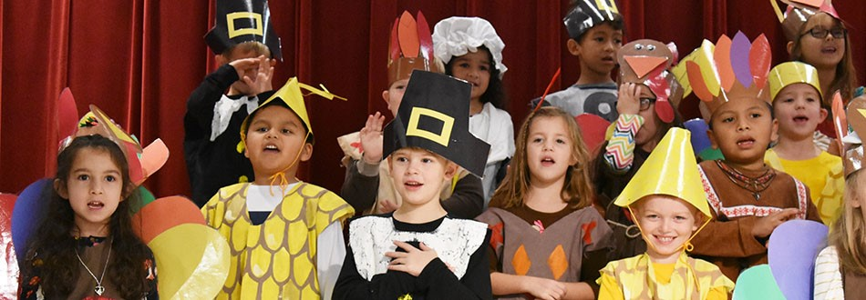 children dressed in costumes for thanksgiving play