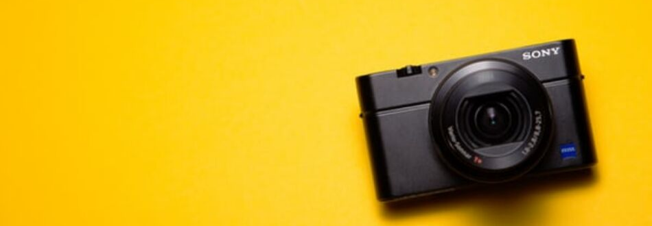 Camera on yellow background