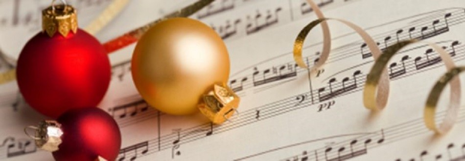 red and gold Christmas balls on sheet music