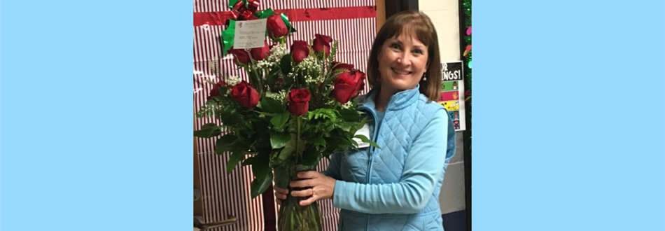 Mrs. Baluch receiving flowers