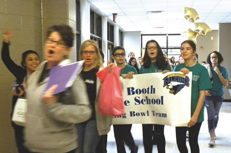 As part of the CCSD Reading Bowl festivities, students parade into the gym carrying special banners as teachers, family and friends cheer them on.