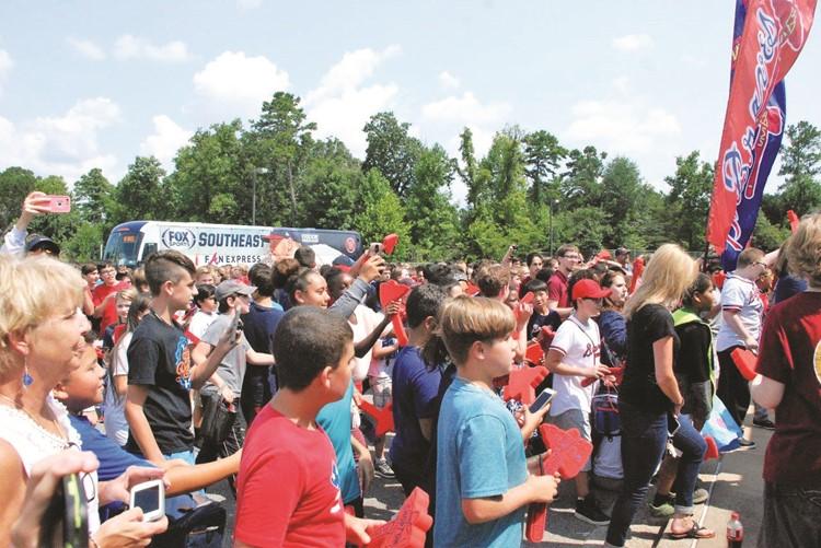 Bronco's seventh-grade classmates cheer him on outside the school.