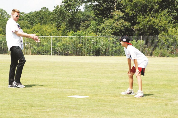 Atlanta Braves player Freddie Freeman and Braves' Community Hero Award winner Mill Creek Middle School seventh-grader Bronco Reece have a brief debate over who should play first base.