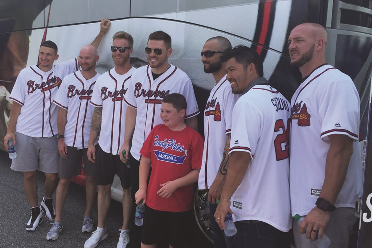 The Atlanta Braves share a special photo with Mill Creek Middle School seventh-grader Jacob McGraw, who also is a heart transplant recipient.