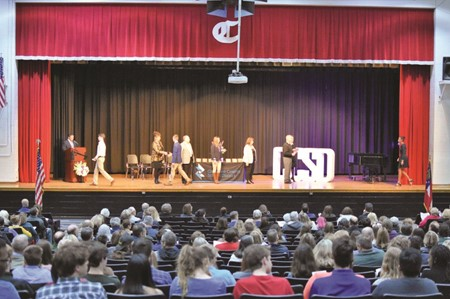 Key Scholars were congratulated onstage during the ceremony Wednesday at Cherokee HS by the Superintendent of Schools and School Board members.