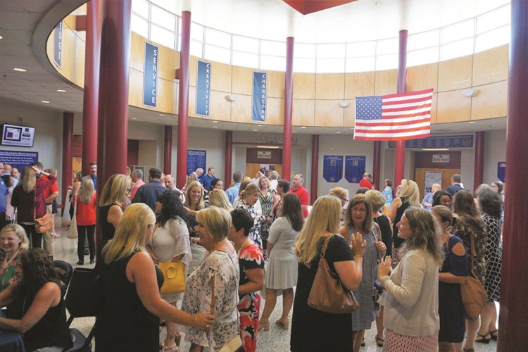 CCSD school and district leaders and guests gather at Woodstock HS on Tuesday afternoon for CCSD's Leadership Symposium kickoff.
