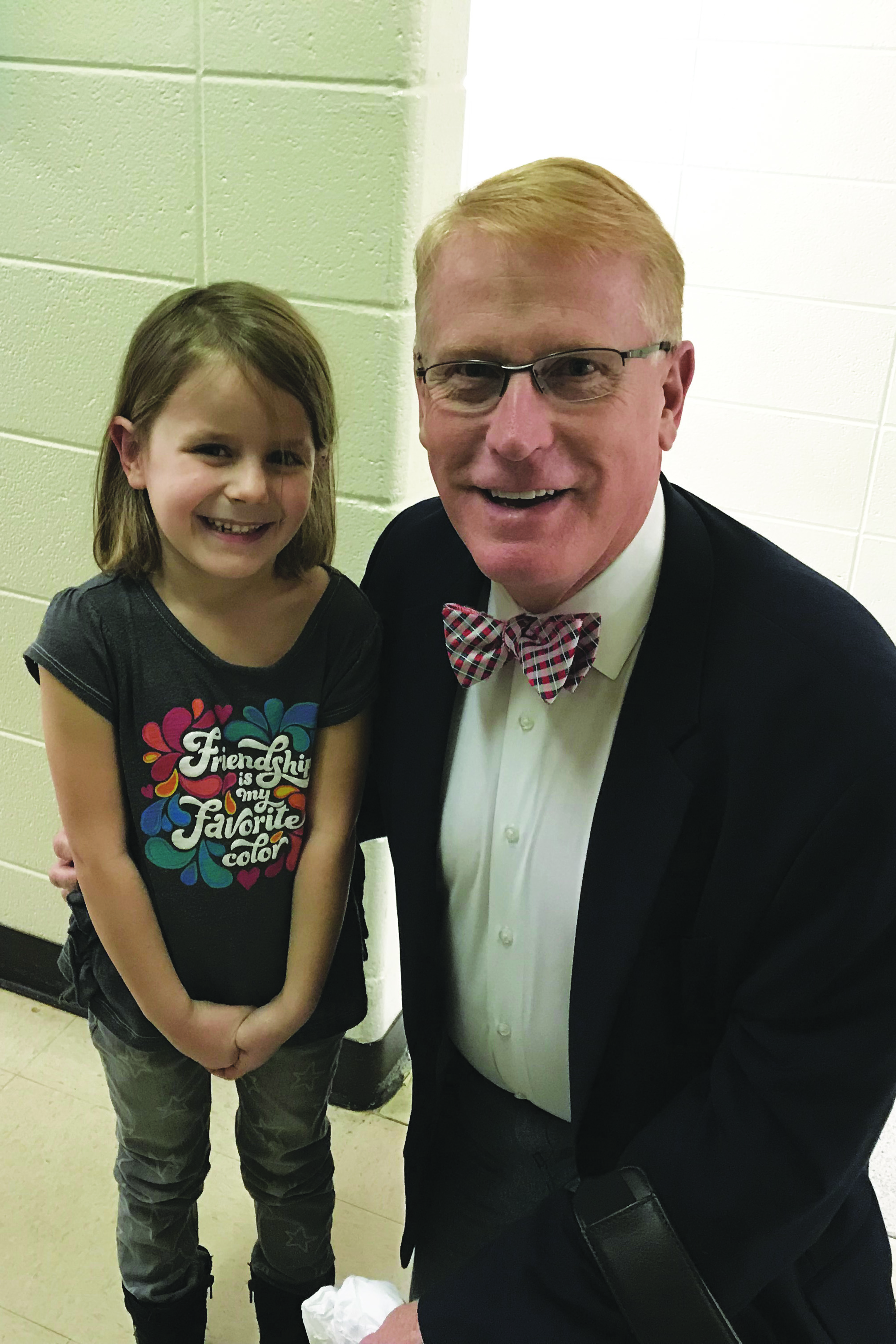 Superintendent of Schools Dr. Brian V. Hightower shares a smile with preK student Kennedy Philpot.