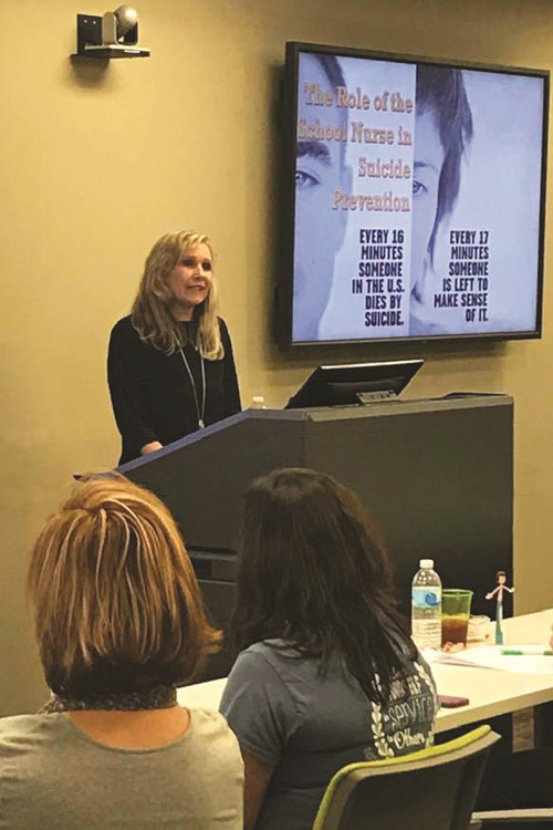 ACE Academy School Nurse Pam Tomeny speaks during the suicide prevention training for CCSD school nurses this week.