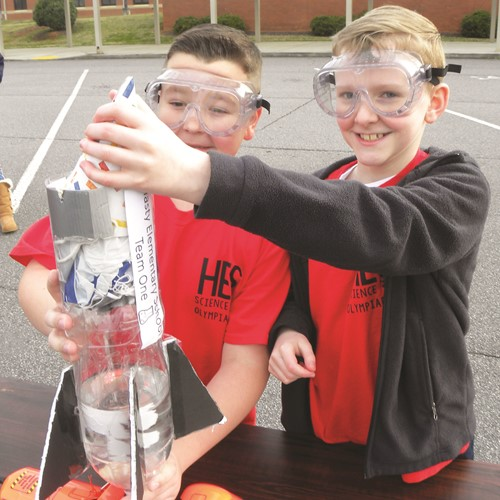 Hasty ES Fine Arts Academy fourth-graders John Palmieri, left, and Bryson Maddox work together.