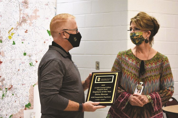CCSD Transportation Department Secretary Debra Basone is congratulated as the CCSD 2020 Support Staff Employee of the Year Award winner for the Central Office category by Superintendent of Schools Dr. Brian V. Hightower.