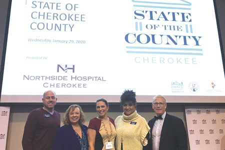 Dr. Hightower, right, was joined at the event by, from left to right, School Board member John Harmon, Chair Kyla Cromer, Vice Chair Kelly Poole and Board members Patsy Jordan and Rick Steiner (not pictured).