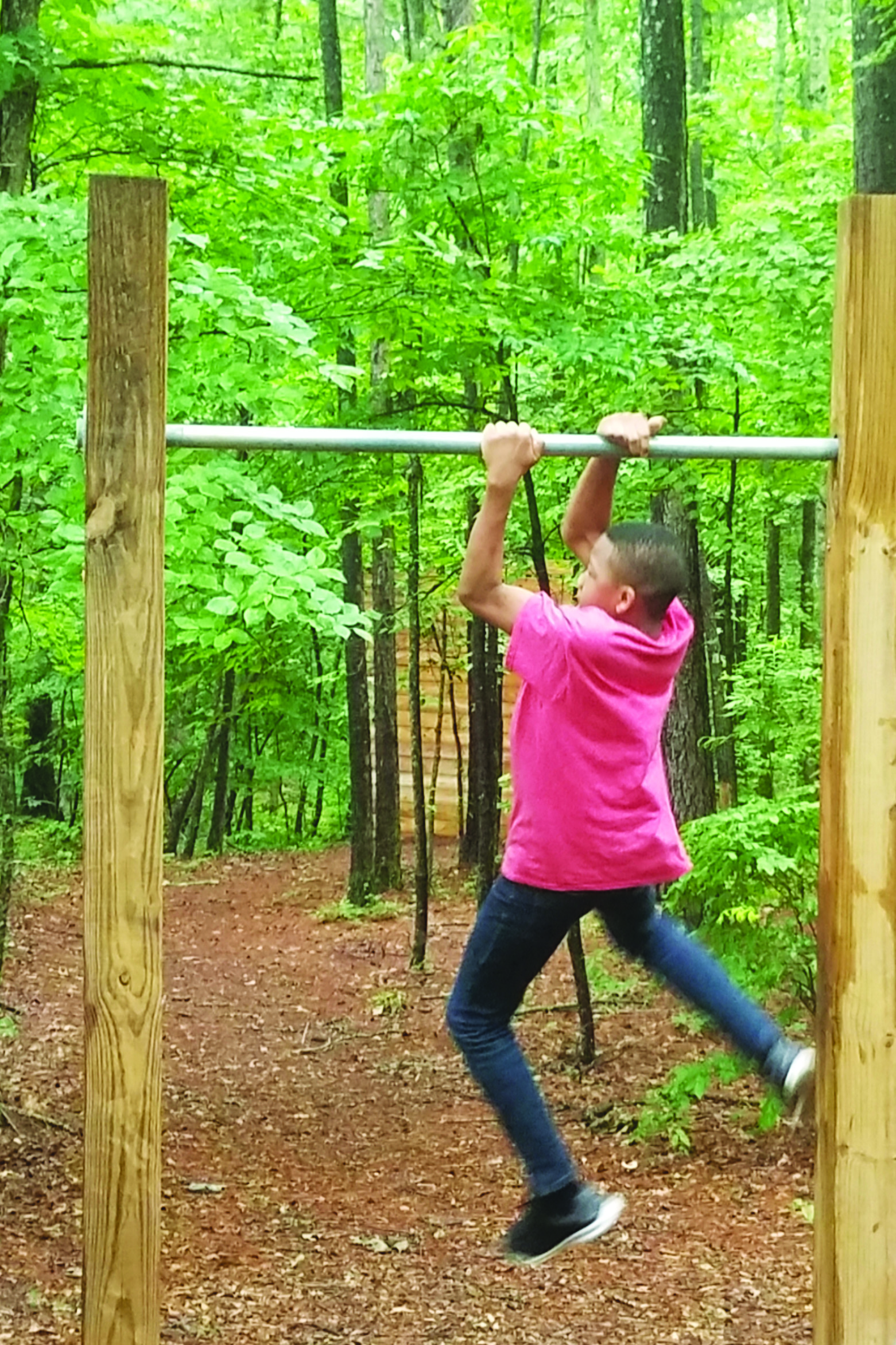 Bo Ogunmuko, a Creekview High School rising freshman, learns about Junior ROTC by trying out its obstacle course during the 'summer bridge' program.