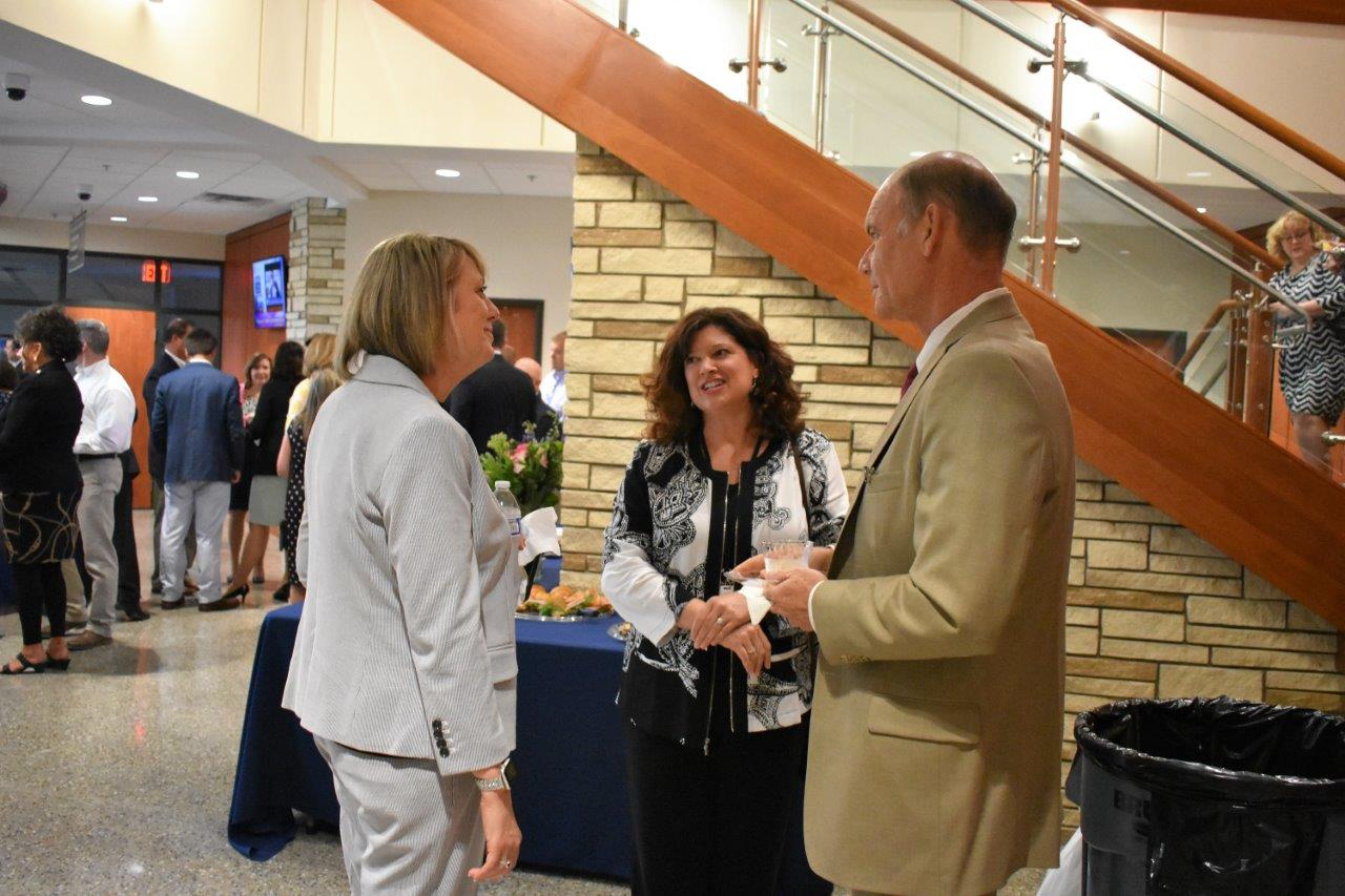 School Board member Mike Chapman speaks with new Indian Knoll ES Assistant Principal Angela Martin, left, and Beth Long, CCSD's executive director of administrative leadership for elementary schools.