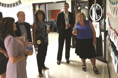 Principal Melinda Roulier, left, explains a hallway display to, from left to right, Superintendent of Schools Dr. Brian V. Hightower, School Board member Patsy Jordan, Deputy Superintendent Trey Olson and School Board Chair Kyla Cromer.