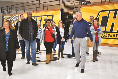 Sequoyah HS Assistant Principal Peter Vajda, right, and School Board Chair Kyla Cromer, left, lead the VILLA class on a tour of the school as part of the field trip.