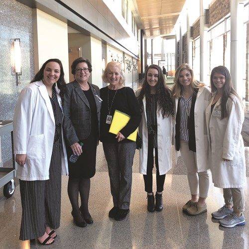 Northside Hospital Cherokee Education Coordinator Mary Jane O'Dell, second from left, and CCSD Work Based Learning students welcome CCSD and educators from across the region, including Susanne McCardle of Cherokee High School, for a tour of the hospital.