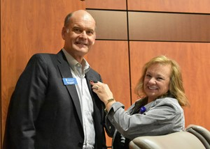 board chair presents service pin