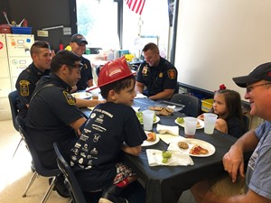 RR winners lunch with firemen